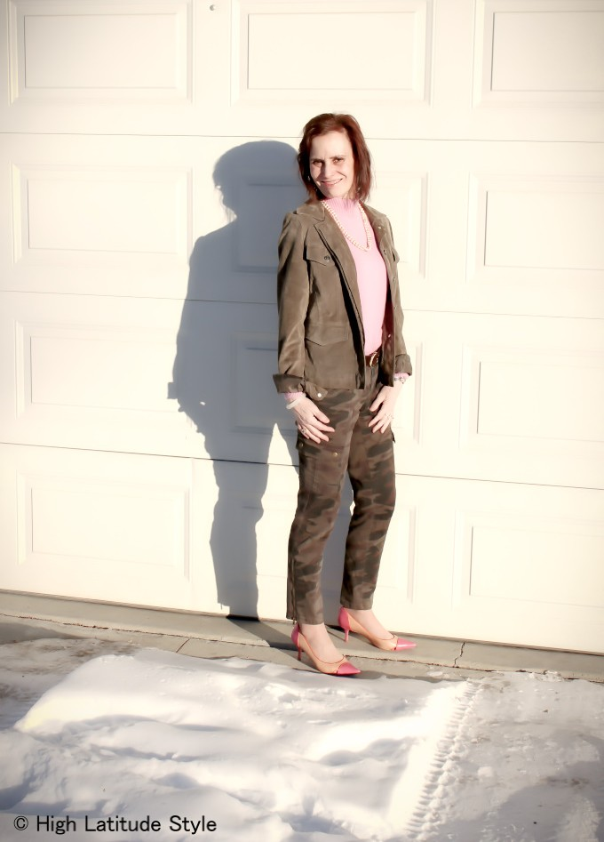 influencer in pink with camouflage neutral outfit