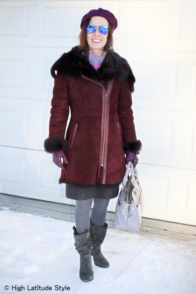 #fashionover50 mature woman in motorcycle shearling coat with mirrored sunglasses that create interest in this winter outfit