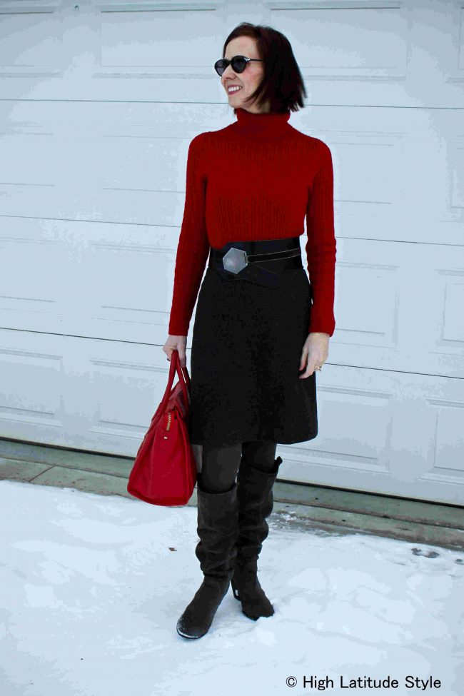 red sweater with classic tweed skirt and boots outfit