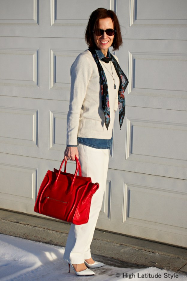 #fashionover40 Casual spring office look with white pants and sweater for mature women