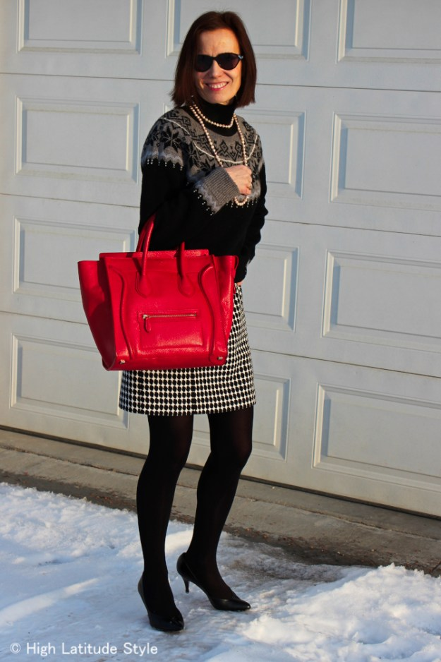 #fashionover50 mature women wearing a sweater over a sheath dress as a skirt and sweater look