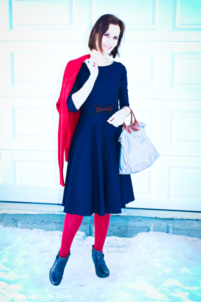midlife blogger in posh chic in a fit-and-flare dress for a winter dinning invitation