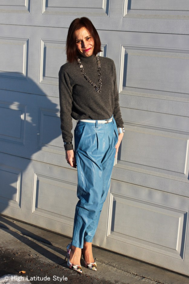 fashion blogger in leather pants and turtleneck sweater