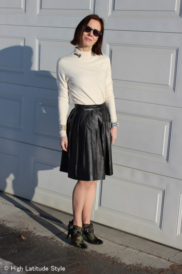 #fashionover40 Mature woman in street style wearing a pleated leather skirt