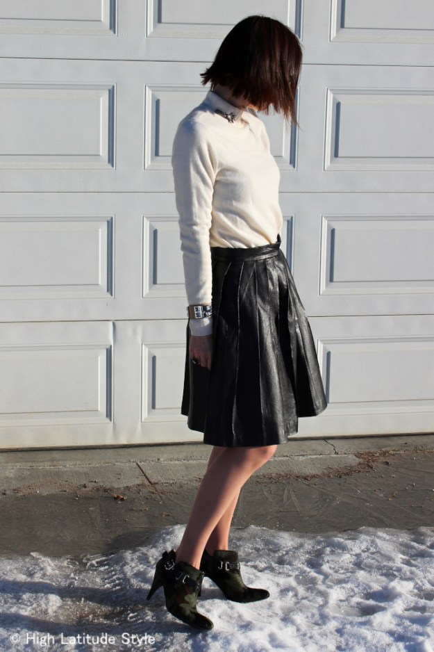 #fashionover40 midlife woman in street chic pleat skirt and mockneck sweater