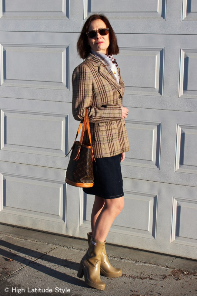 #over40fashion Alaskan woman wearing layers in spring for a casual work outfit with plaid blazer and denim skirt
