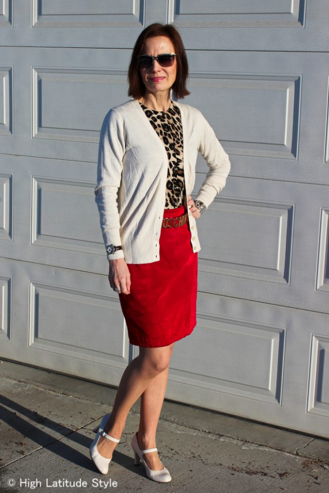 Style blogger Nicole in office look with layering of a leopard print top under a cardigan