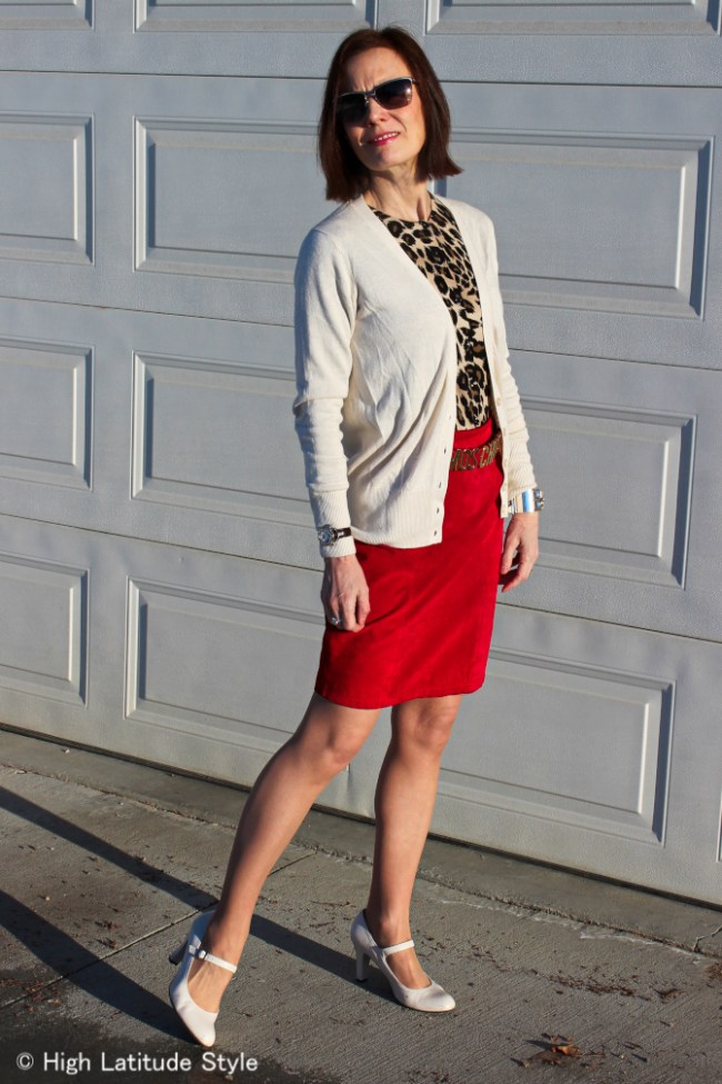 Style blogger layering two cardigans for a business casual work outfit on a chilly, windy spring day