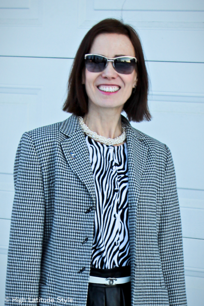 #over50fashion woman mixing zebra print and hounds tooth in a work outfit