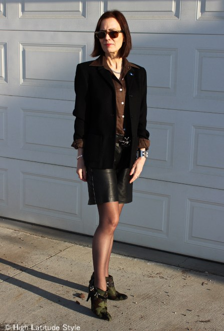 #fashionover50 woman in leather shorts with tight, blazer and shirt