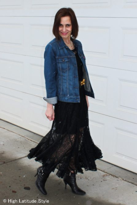 influencer in dinner party outfit with denim jacket and lace dress