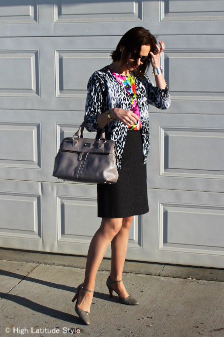 over 50 years old fashion blogger in floral and snowleopard cardigan with tweed skirt