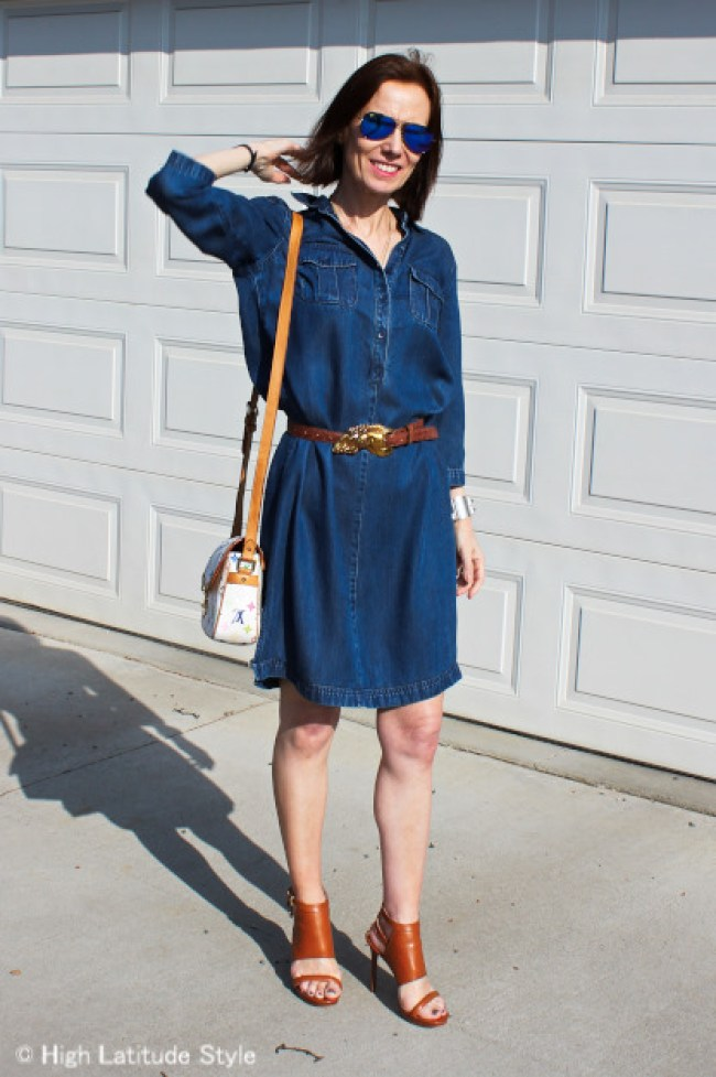 #fashionover50 midlife woman in chambray dress, sandals, and mirrored sunglasses