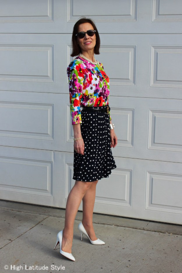 #styleover40 Floral top with polka dot pleated skirt