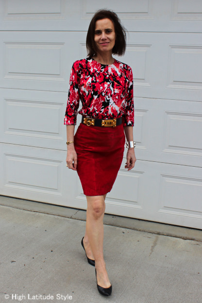 stylist in red skirt and printed jacket
