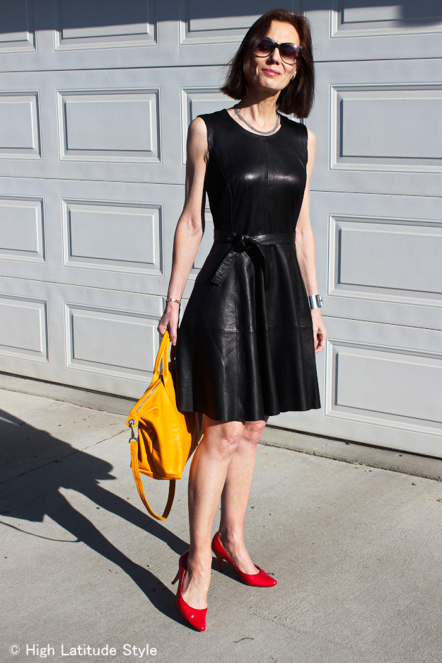 midlife woman in fit-and-flare leather dress styled for summer
