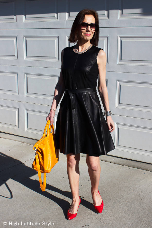 #leatherlady midlife woman in leather fit-and-flare dress with red pumps looking like a dancing Queen