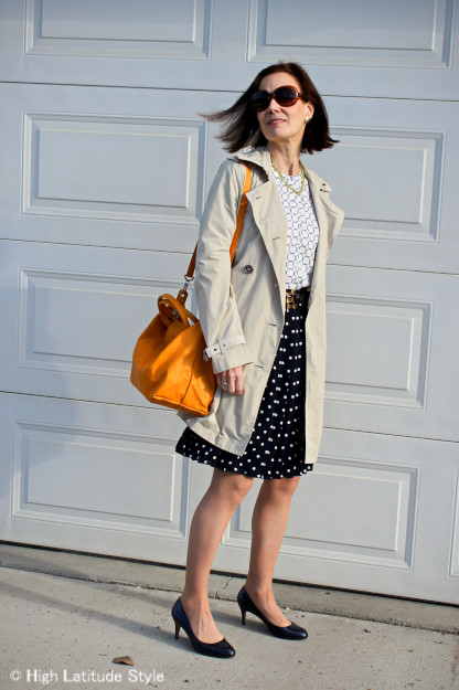 advancedFashion woman wearing a trench coat and polka dot skirt