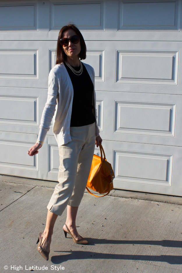 midlife woman in posh work outfit with dressy capris