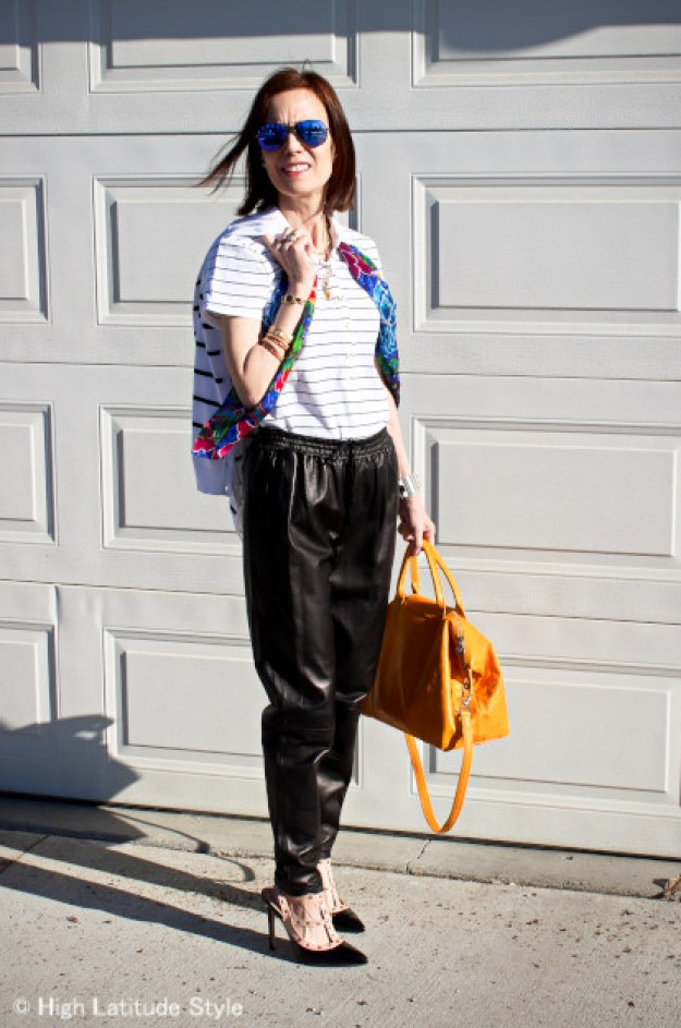 #fashionover50 mature woman in a cool weekend look with leather joggers
