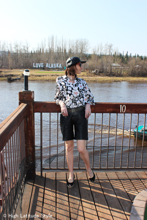 #fashionover50 #agelessstyle mature woman in leather shorts, Hawaiian shirt and leather baseball cap
