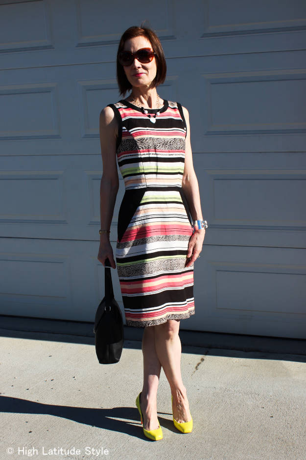 #fashionover50 woman with a statement necklace styled with a sheath dress