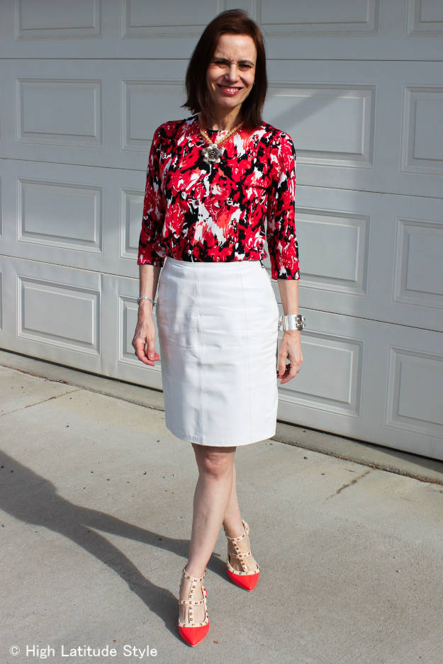 mature style blogger presenting how to look office appropriate in a floral top