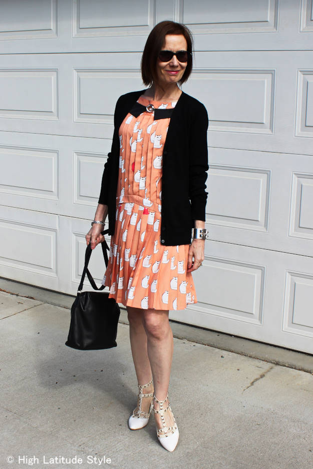 #Fashionover40 mature woman in cat dress with cardigan