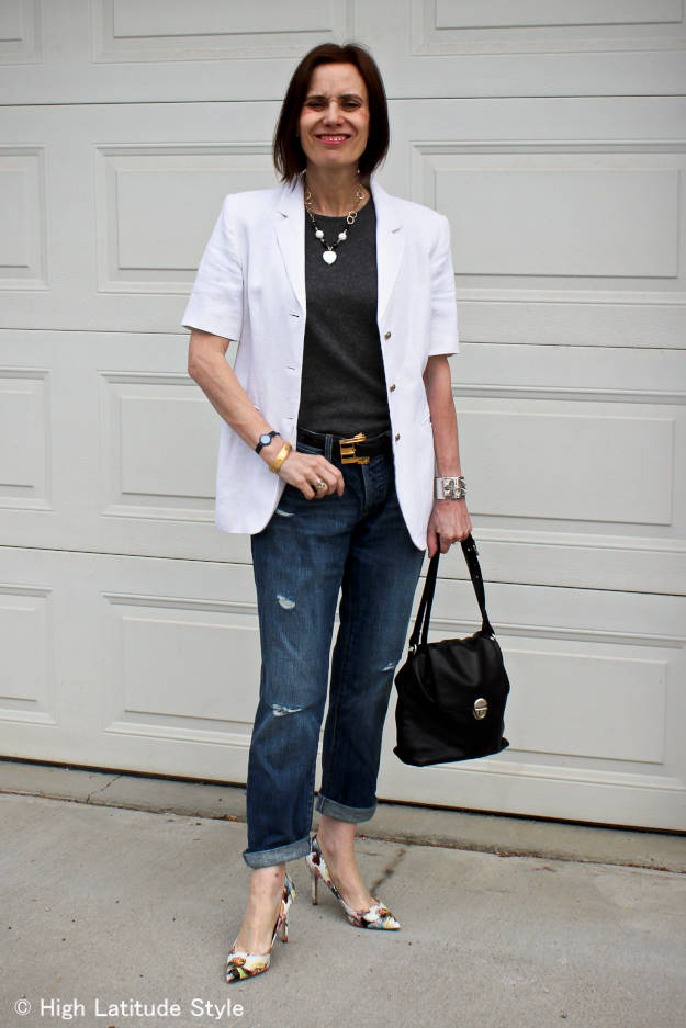 mature style blogger in polished style with distressed jeans