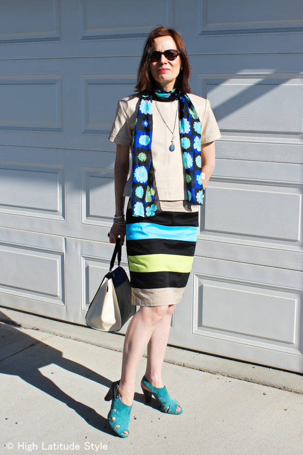#over50fashion style blogger in leather top, floral print scarf and striped skirt