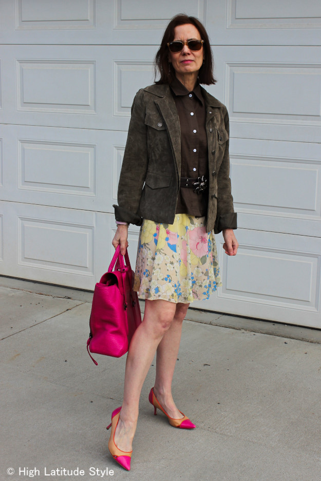mature woman with floral skirt and suede utility frock