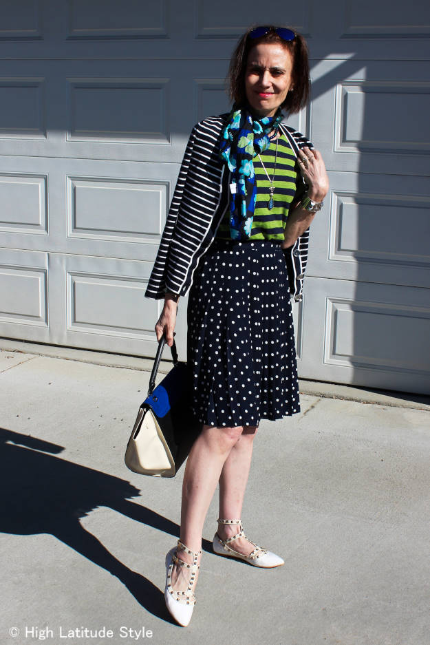 #fashionover50 mature woman looking posh and dressy in mixed stripes and polka dots for film night
