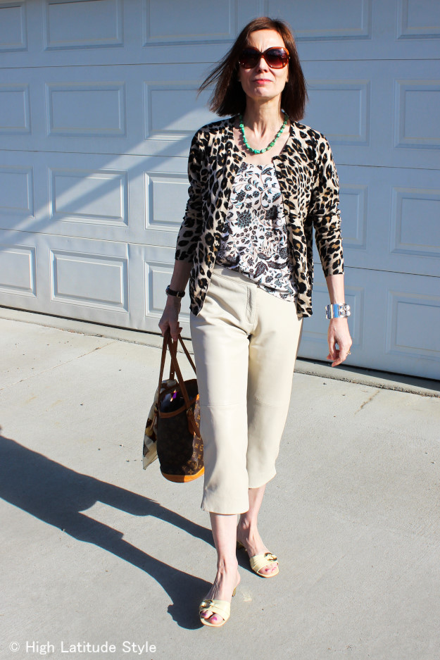 midlife Alaskan blogger in leopard Print Cardigan with floral Tank Top and leather Capri in Fairbanks
