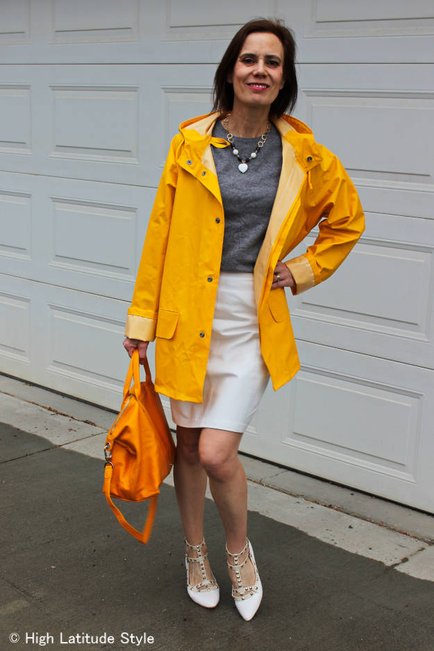 #fashionover50 woman wearing a man's raincoat