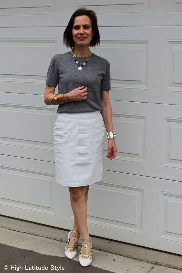 mature woman in all neutral work outfit