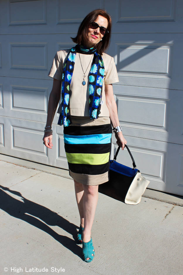 Style blogger wearing a silk scarf, bold striped eShakti skirt and leather top for a work outfit
