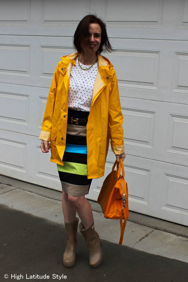 #over40fashion woman in yellow men's rain coat styled in a feminine way