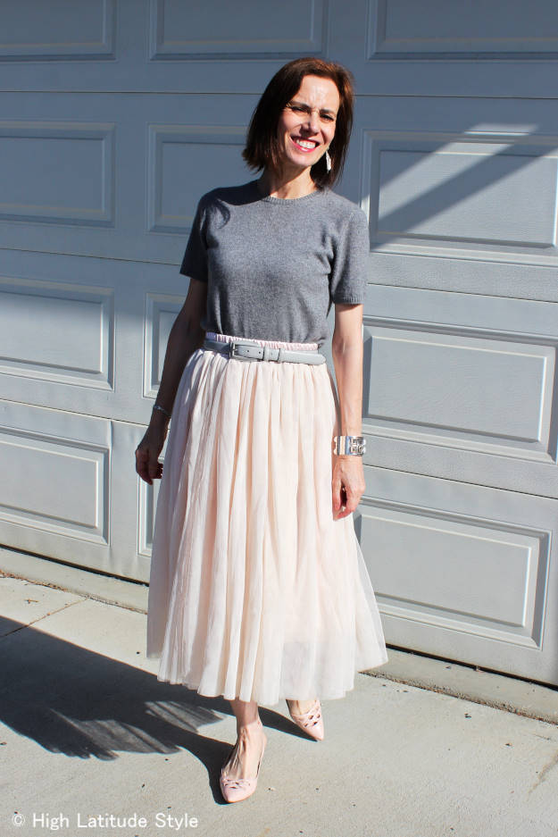 mature woman in nude mesh tulle skirt styled with blush pinks