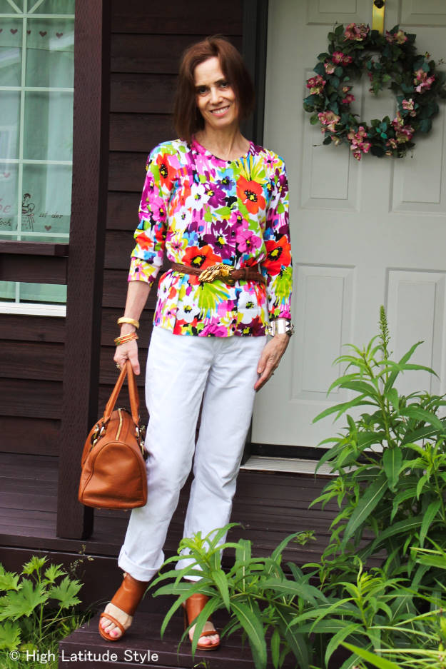 midlife blogger in white denim pants and floral top