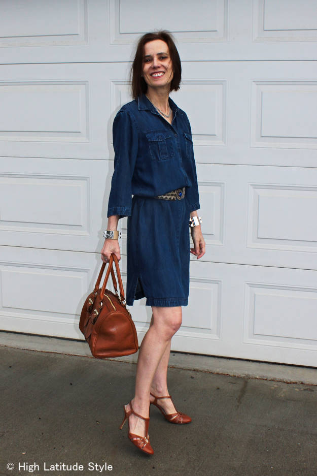 older woman in denim dress and T-strap sandals
