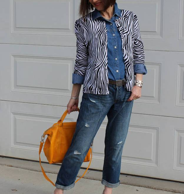 Fashion over 50 woman in distressed jeans