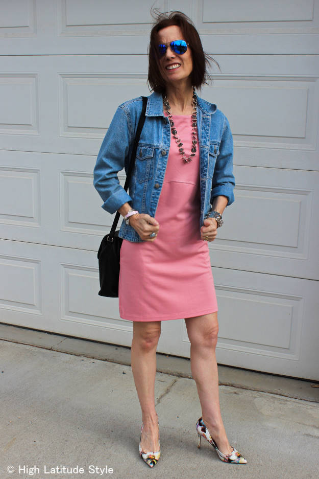 #styleover40 woman in baby pink dress with washed denim jacket