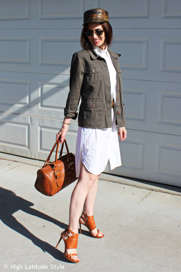 #fashionover40 woman in little white dress with utility jacket and hat