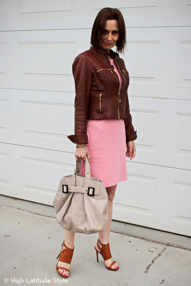 street style blogger in tailored leather jacket and pink dress