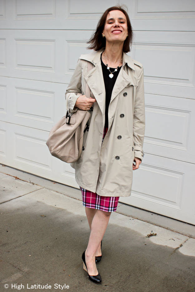 Fashion blogger Nicole in Burberry pink plaid skirt with striped cardigan and jade and onyx necklace styled for work