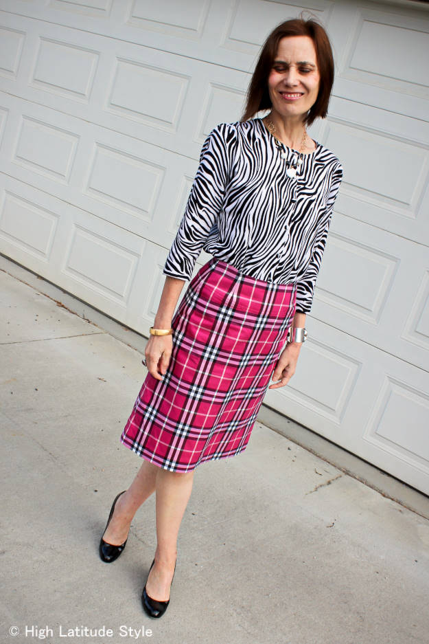 over 50 years old fashion blogger in mixed print trend with zebra and plaid