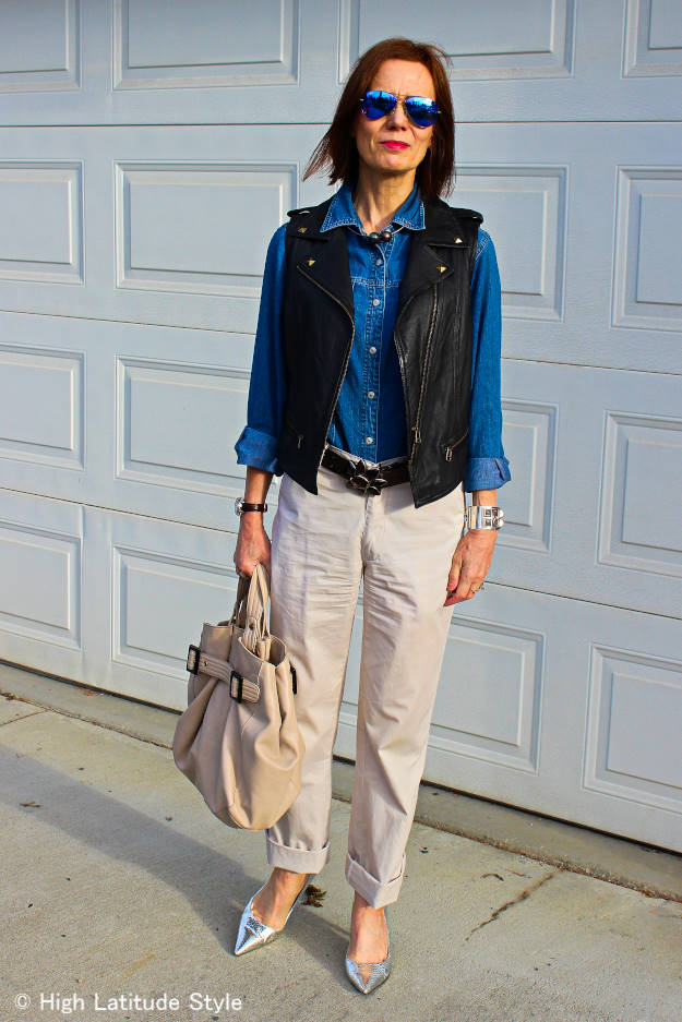 #streetstyle style blogger with denim shirt, leather vest, sunnies, and silver pumps