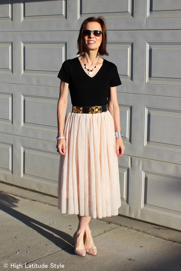 #LookbookStore #streetstyle  woman in black sweater and blush pink skirt