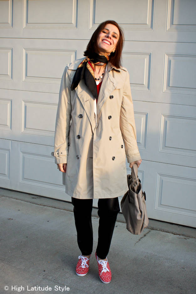 over 50 years old woman in Keds with trench coat