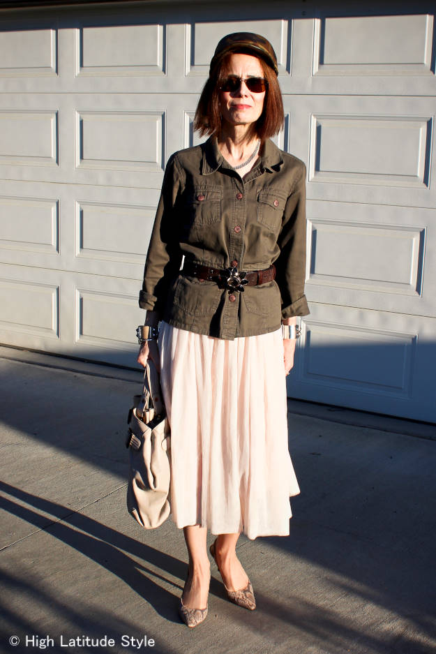 mature style woman in meshskirt with military inspired jacket